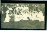 [Women in white dresses with a few men in suits]
